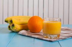 Orange juice in glass, fresh fruits on wooden Stock Photo