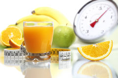 Orange juice in glass, fruit meter scales diet food Royalty Free Stock Image