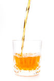 Orange juice into the glass isolated Stock Images