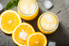 Orange juice in glass with mint, fresh fruits. selective focus, Royalty Free Stock Image