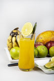 Orange Juice in Glass and Mixed Fruits  Royalty Free Stock Photo