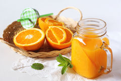 Orange juice in a glass mug Stock Photography