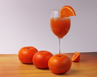 Orange juice glass with oranges Royalty Free Stock Photos