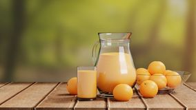 Orange Juice with Glass and Pitcher on Wooden Floor royalty free stock images
