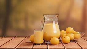 Orange Juice with Glass and Pitcher on Wooden Floor royalty free stock photo