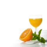 Orange juice in glass with slice of orange. Stock Photo