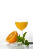 Orange juice in glass with slice of orange. Stock Photography