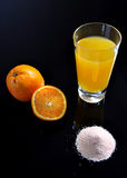 Orange juice glass, sliced orange and juice powder Stock Photos