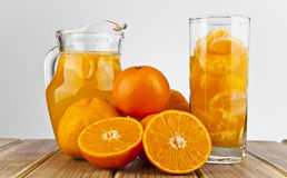 Orange juice in glass and slices. Isolated on white background Royalty Free Stock Photography