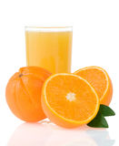 Orange juice in glass and slices on white. Background Stock Photo