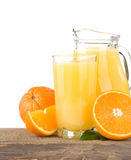 Orange juice in glass and slices on white Royalty Free Stock Images