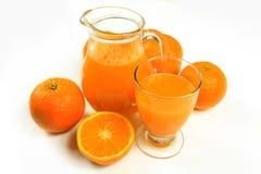 Orange juice. Glass of orange juice on white background Royalty Free Stock Image