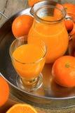 Orange juice. Glass of orange juice on white background Royalty Free Stock Photography