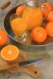 Orange juice. Glass of orange juice on white background Royalty Free Stock Images