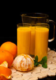 Orange juice with glasses Stock Images