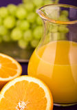 Orange juice with grapes Stock Image