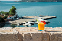 Orange juice grass with sea views. Royalty Free Stock Images
