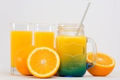Orange juice gray background. Glass of fresh orange juice on a gray background Stock Photos