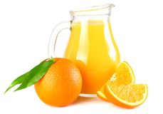 Orange juice with orange and green leaf isolated on white background. juice in jug Royalty Free Stock Image