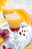 Orange juice with grenadine sirup Stock Images