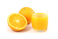 Orange juice. And half of orange on white background Royalty Free Stock Photography