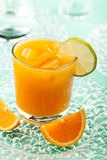 Orange juice with ice Stock Images