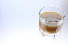 Orange juice. On the illuminated desktop Royalty Free Stock Photo