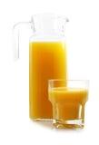 Orange juice jug and glass Royalty Free Stock Photos