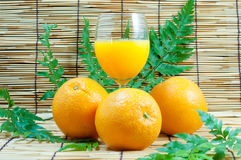 Orange and juice with leafs. Orange and Orange juice with leafs Royalty Free Stock Image
