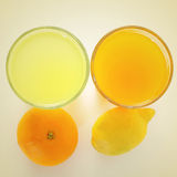 Orange juice and lemon juice Royalty Free Stock Images