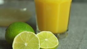 Orange juice and limes for chocolate mousse with orange jelly. In the kitchen stock footage