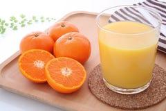 Orange juice with mandarin orange Royalty Free Stock Images