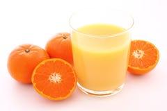 Orange juice with mandarin orange Stock Images