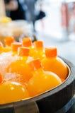 Orange juice. Many bottle of cool orange juice in box Stock Image