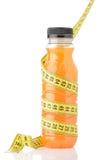 Orange juice with measuring tape Stock Photos