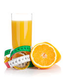 Orange juice and measuring tape. Diet food Royalty Free Stock Photos