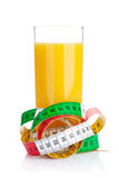 Orange juice and measuring tape. Diet food Stock Photos