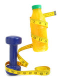 Orange juice with measuring tape and dumbbell Stock Image