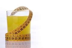 Orange juice and measuring tape Royalty Free Stock Photos