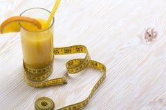 Orange juice and measuring tape Stock Photo