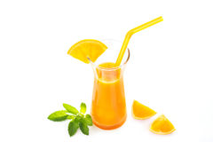 Orange juice with mint and slices of fresh orange on white backg Royalty Free Stock Photo