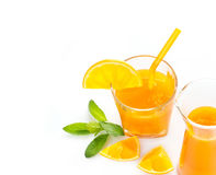 Orange juice with mint and slices of fresh orange on white background Royalty Free Stock Images
