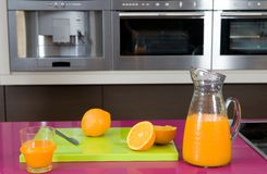Orange juice in a modern kitchen Royalty Free Stock Image