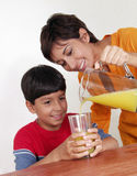 Orange juice mother. Royalty Free Stock Images