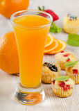 Orange juice and muffins Royalty Free Stock Photos