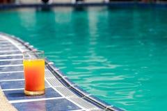 Orange Juice Near Water Pool royalty free stock photo
