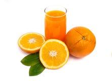 Orange juice and orange fruits with green leaves. On white background stock image