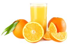 Orange juice with orange and green leaf isolated on white background. juice in glass Stock Images