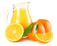 Orange juice with orange and green leaf isolated on white background. juice in jug stock images