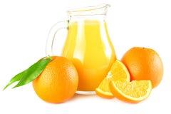 Orange juice with orange and green leaf isolated on white background. juice in jug Stock Photography